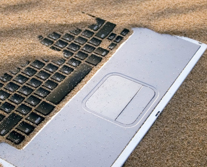 Laptop Covered in Sand
